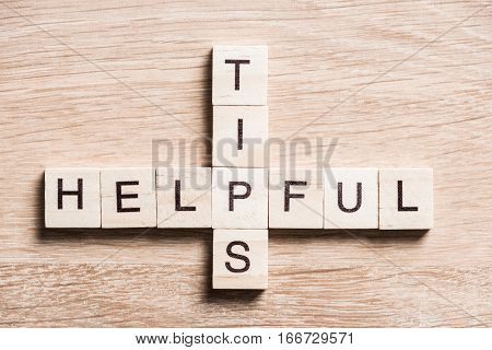 Crossword puzzled with blocks spelling helpful and tips words