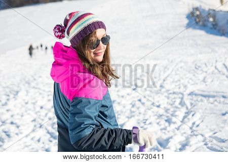 Girl With Hiking Sticks On The Snowy Mountain