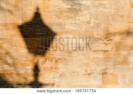 Street Lamp Shadow On Old Stone Wall Texture