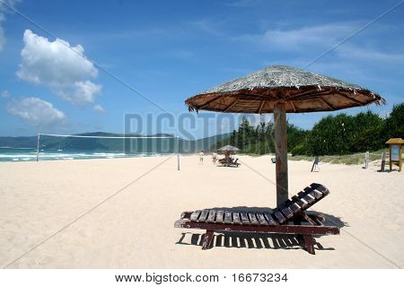 perfect holiday with chairs and umbrella on the beach