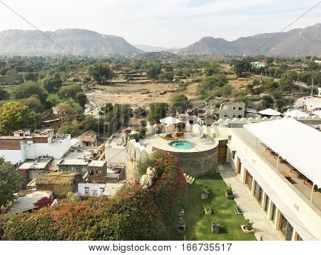 UDAIPUR INDIA - JANUARY 14 2017: RAAS Devigarh Hotel view. Nestled in the Aravalli Hills of the Udaipur area an 18th century palace has spectacular views of the valley.