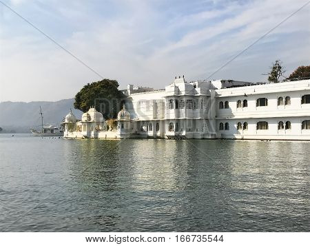 UDAIPUR INDIA - JANUARY 14 2017: Taj Lake Palace Hotel. One of the most recognizable residences in the world was featured in the films Octopussy and The Jewel in The Crown.