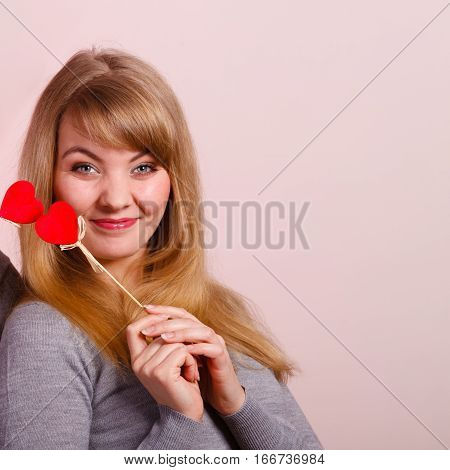 Lovely Girl Playing With Hearts On Sticks.