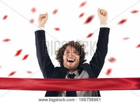 Successful victorious businessman comes to the red ribbon of victory