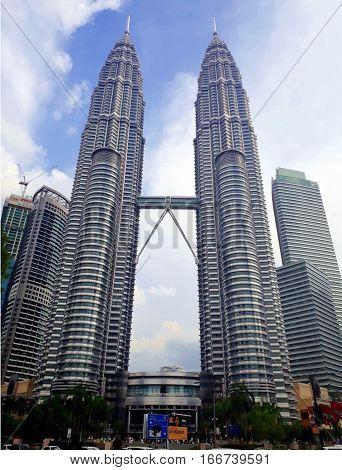 KUALA LUMPUR MALAYSIA - JANUARY 14 2017: Petronas Twin Towers at KLCC City Center. The most popular tourist destination in Malaysian capital