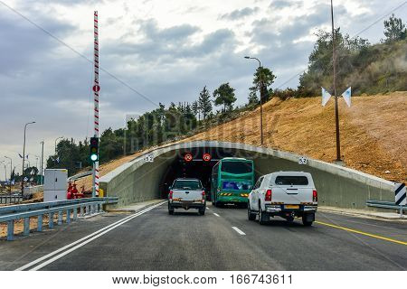 Car driving on to tunnel. entry into a new tunnel in Jerusalem