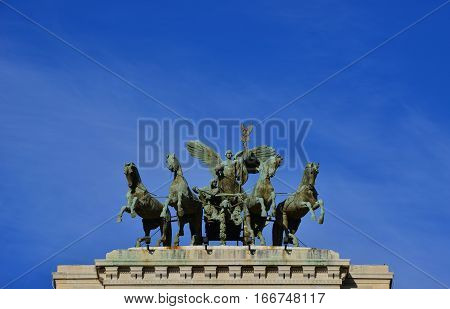 Goddess of Justice bronze quadriga at the top of old Palace of Justice in Rome with blue sky and copy space