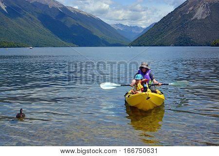 Rotoiti New Zealand - December 26 2016: Man and child kayaking on Lake Rotoiti in Summer.