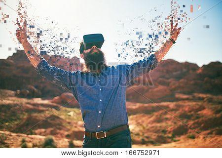 bearded guy in desert wearing vr glasses dissolving into pixels