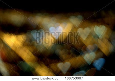 numerous hearts of multiple colors on an abstract bokeh effect background