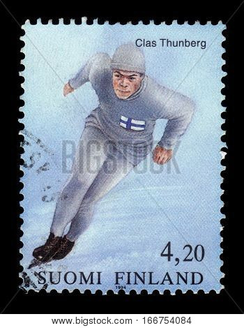 FINLAND - CIRCA 1994: a stamp printed in Finland shows Clas Thunberg, finnish speed skater, olympic champion, International Olympic Committee 100 years., circa 1994