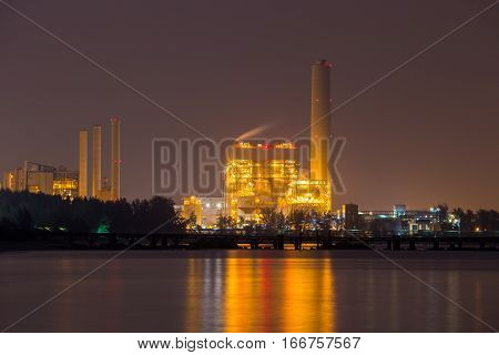 Electrical Power Plant Near Sea Coat At Night, Rayong, Thailand