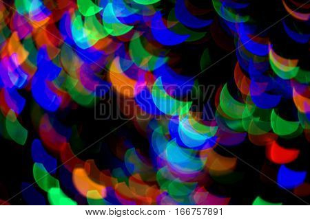 crescent moon red green blue multicolored bokeh effect abstract dark black background
