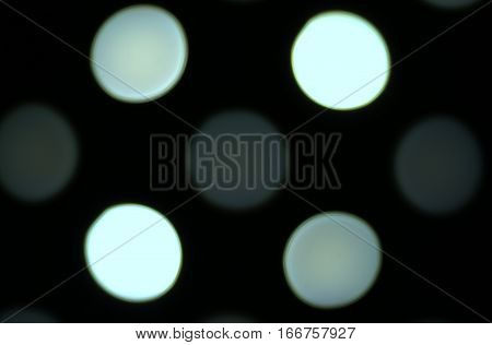 white dots round circles bokeh effect dark black background