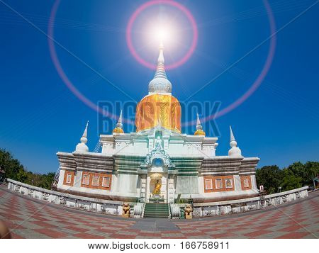 Ancient pagoda architecture In Thailand, Phra That Na Dun , Maha Sarakham Province with blue sky background and Lens Flare or sunspot