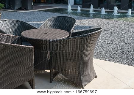 rattan sofa and table set in a garden