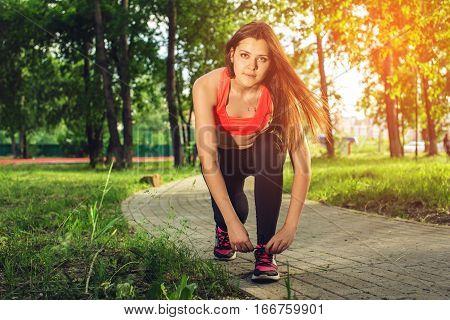 Running Shoes - Closeup Of Woman Tying Shoe Laces.