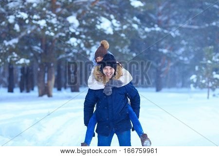 Playful Couple Walking Outdoors In Snowy Woods