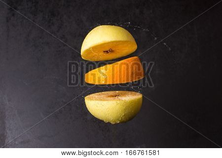 Levitating Fresh Sliced Apple And Orange