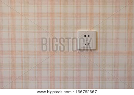 electrical outlet on a wall horizontal composition