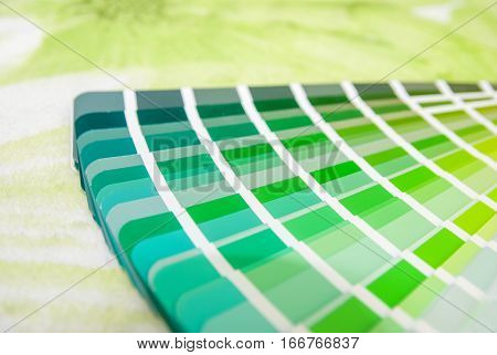 Abstract background of green color swatches close up