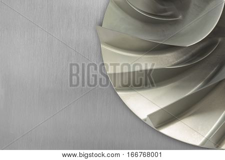 Rotor blade of centrifugal type of gas compressor placed on aluminum sheet background.