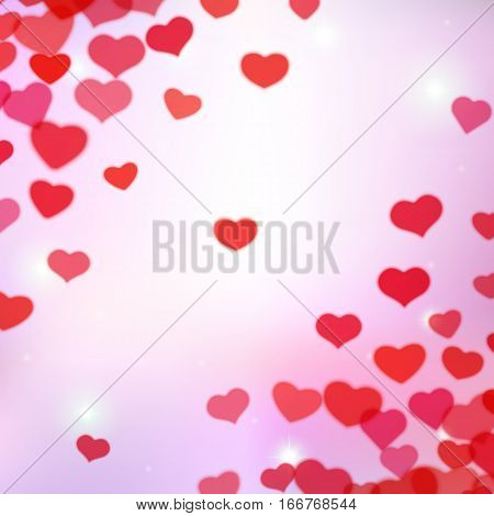 Valentines Day background with scattered blurred hearts