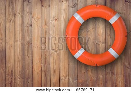 Life buoy hanging on wooden wall for emergency respone when people sinking to weter almost place neer pool and beach