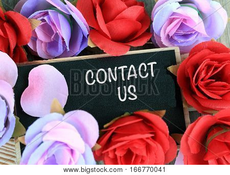 contact us message written on a chalkboard