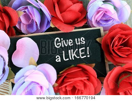 concept of give us a like on a chalkboard