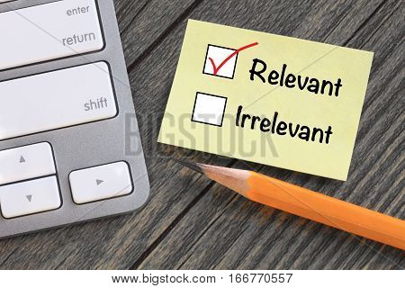 concept of relevant versus irrelevant with desk background