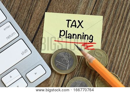 tax planning concept with money on desk