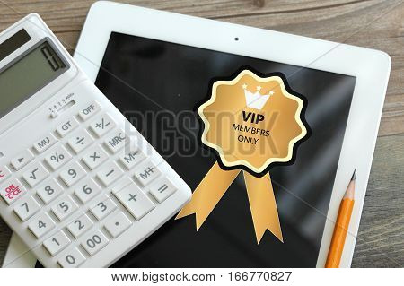 vip badge, customer or very important person concept on a tablet