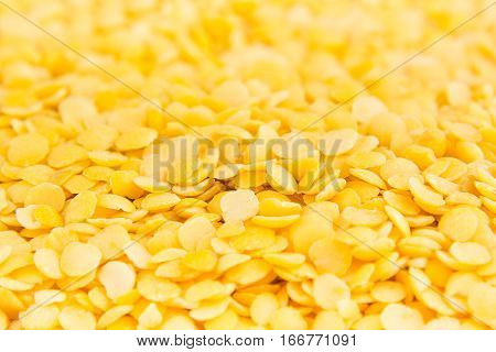 Yellow purified lentil macro background. Healthy protein food.