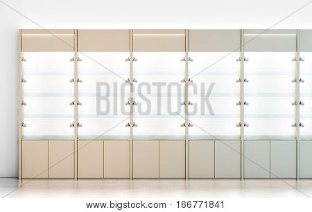 Blank wooden showcase design mockup 3d rendering. Clear white wood show case with empty glass shelves mock up. Store wall with modern cabinet. Shop front view with bright rack template.