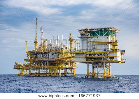 Oil and gas living quarter, oil and gas processing platform and wellhead remote platform in the gulf of Thailand.