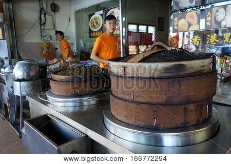 Vendor Selling Dim-sum In Large Steamer Baskets