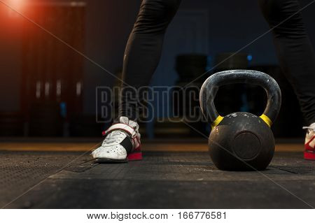 Male Athlete Preparing For Kettlebell Workout