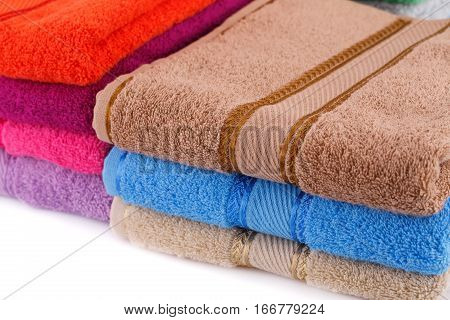 Colorful towels stack horizontal close up picture.