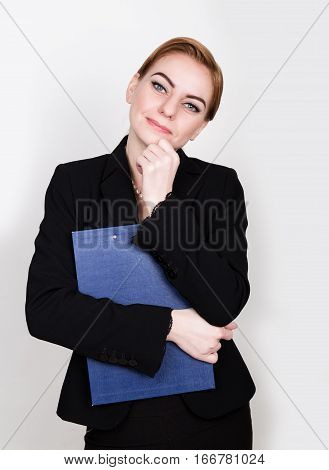 Attractive and energetic business woman holding pad for writing.