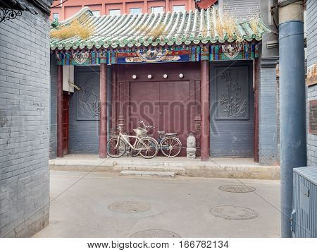 Beijing, China - Oct 30, 2016: Traditional Chinese home entrance around Dong Cheng area. Such architecture style is common in Old Beijing streets or alleys called Hutongs. This entrance is from Cuihua Hutong.