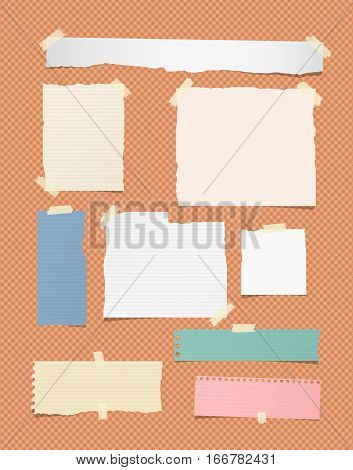 Ripped ruled different size white and colorful note, notebook, copybook paper sheets, strips stuck on orange squared background.