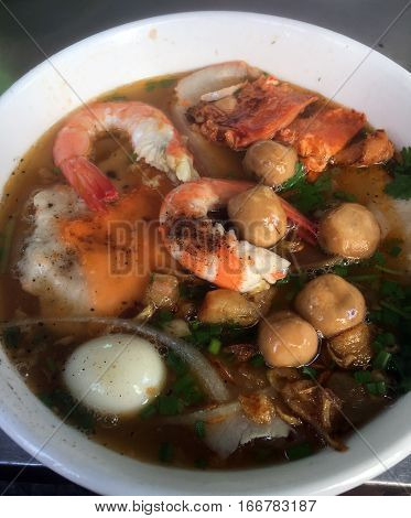 Big closup bowl of Banh Canh, Vietnamese traditional soup with big rice noodles. Crab Noodle Soup. Mobile Photo