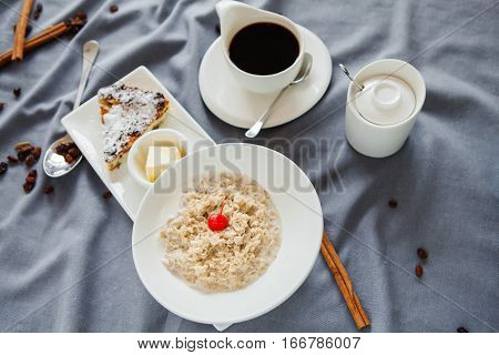 set Breakfast of oatmeal and appetizing pastries