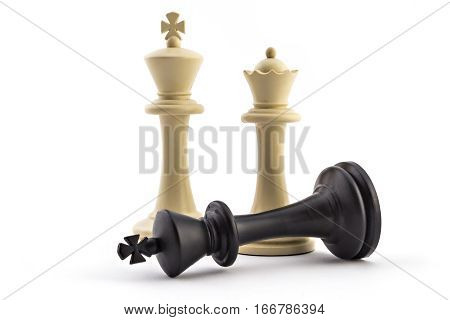 Chess business concept, leader & success. White king and queen above defeated black king