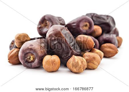Bunc of date palm and hazelnuts, dried dates isolated on white background