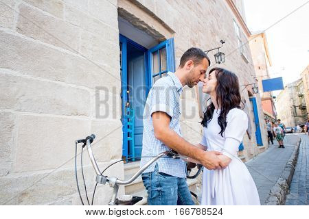 Young Couple On Tandem Bicycle At The Street City