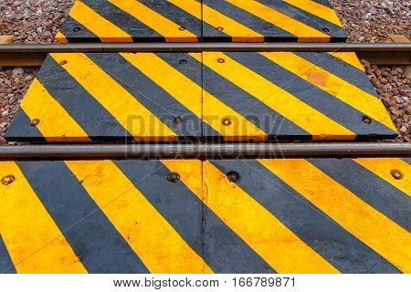 Railway and the warning sign in Thailand