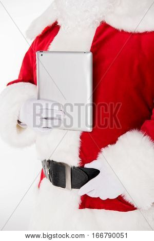 Cropped image of Santa Claus posing with digital tablet in hand