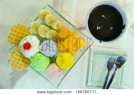 Low fat homemade Ice-cream with berry whip cream served with sliced banana waffle and chocolate fongdu a very famous sweet dessert in Thailand